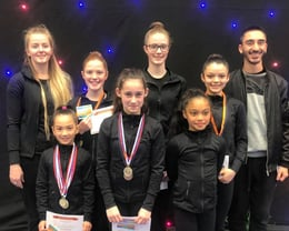 Coaches Ellie and Sergi with gymnasts at Melbourne